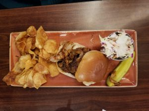 Pulled pork sandwich and house chips